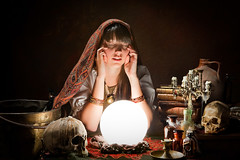 Diviner predicting the future with a crystal ball (Psychic Base) Tags: astrology ball bright crystal crystalgazer diviner fantasy fortune fortuneteller future gypsy halloween light magic magical magician mind mystery mystical occult occultism pagan palmistry paranormal people predict prediction reading retro scry scrying skull soothsayer soothsaying sorcerer sphere spooky supernatural superstition tarot teller vintage voodoo wicca witchcraft wizard woman young