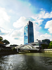 Travelling Through Clarke Quay (Steve Taylor (Photography)) Tags: clarkequay art digital architecture building bridge office blue green white glass water river asia singapore cloud sky sunny