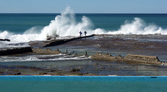 Surfers entering the water at Woonona (Celeste33) Tags: woonona surfers waves surf sea ocean foam spray australia