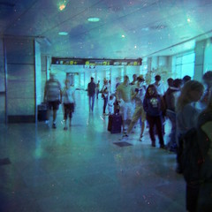 Fast-paced queues (ale2000) Tags: analog analogue holga lomography film 6x6 120 square filmisnotdead believeinfilm vignette vignetting blue azzurro mosso blurred blurry experiment bleach bleached airport aeroporto leaving travel traveling street streetphotography queue coda people