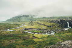 Foss og áin, Austurland. (Matthieu Robinet) Tags: iceland island panorama amazing nature stunning origins green landscape smokey fog cloudy day clouds waterscape waterfall giant escape exploring discover massive alone nobody grass outdoor volcanic roadtrip coast river reyk tones colors natural compactexpert lumix horizon faraway