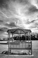 "when the music stops, fine art B&W of deserted bandstand and park bench, Jardin des Personalites, Honfleur, Calvados, Normandy, France (grumpybaldprof) Tags: bw blackwhite ""blackwhite"" ""blackandwhite"" noireetblanc monochrome""fineart"" ethereal striking artistic interpretation impressionist stylistic brightcontrast shadow bright dark black white illuminated honfleur normandie normandy france ""jardindespersonalites"" ""gardenofpersonalities"" gardens ""seineriver"" ""laseine"" personalities plants water flowers features bandstand ""kiosqueàmusique"" ""culturalheritage"" ""historicalheritage"" patrimoine bancdeparc parkbench park bench garden seat clouds sky calvados fineart canon 70d ""canon70d""tamron 16300 16300mm ""tamron16300mmf3563diiivcpzdb016"" hdr"