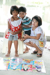 children with their coloring books