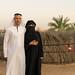 With hijab and abaya