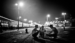 In Between The Trains (Camille Marotte) Tags: 2014 vietnam hanoi train trains station black white contrast dark night people vietnamese cinematic mood trainstation tracks city street streetphotography sigma canon 1dc travel travelling backpack adventure friends floor light lights urban spontaneous camille marotte