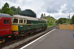 Loco D6515 (33012) slowly draws away from Corfe Castle Station with its iconic backdrop, on the 14.26 service from Swanage to Wareham. 23 07 2017 (pnb511) Tags: swanagerailway class33 mainline running westcoastrail train rails railway loco locomotive diesel castle ruin