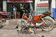 bike repair shop (DOLCEVITALUX) Tags: motorbike motorcycle repairshop philippines lumixlx100 panasoniclumixlx100