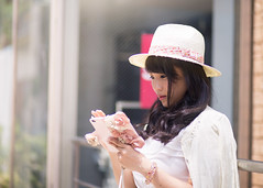 Young woman using smart phone in city (Apricot Cafe) Tags: img660900 asia asianandindianethnicities canonef85mmf18usm harajuku healthylifestyle japan japaneseethnicity tokyojapan beautifulwoman buildingexterior carefree charming cheerful colorimage day elegance enjoyment happiness horizontal leaning lifestyles longhair oneperson onlyjapanese onlywomen onlyyoungwomen outdoors people photography railing sideview smartphone smiling strawhat street summer waistup window women youngadult