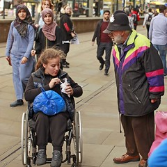 The wrong arm of the law :-) (Mick Steff) Tags: tommy manchester urban street people police wheelchair kids children piccadilly rat