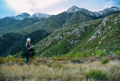 Woman hiking in Marloth with snow (Atelier Design Studio) Tags: swellendam overberg snow snowing peaks marlothnaturereserve marloth holiday winter mountains mountain clock 11oclockpeak 12oclockpeak 1oclockpeak twofeathershorsetrails walk hiking familyhike cold countrylife walking hikers atelierdesignstudio royaltyfree snowcapped langeberg country countryliving weekend forest green