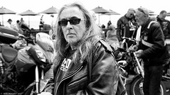 Classic, shades and leathers. (Neil. Moralee) Tags: neilmoralee niker motorcyclist man face portrait candid black white mono monochrome nikon d7200 neil moralee street hair long shades sunnies glasses sun leather jacket hells angels teignmoth devon air ambulance charity ride out uk sea side bw bandw blackandwhite