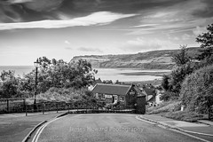 Top of robin Hood's Bay Bank (jameshowardphotography) Tags: bay robin hoods black white mono monochrome water sea seascape clouds road old