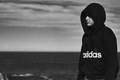 Boy in his hood (rvrossel) Tags: boy hood adidas sea beach coulds coast tathra nsw blackandwhite noiretblanc blancoynegro fujixt10 helios44m58mmf2 fujixseries fujishooters fujilove
