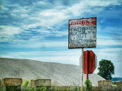 Picturesque Ambiguity (toddturner1) Tags: stop notice signs summer clouds grunge disrepair stone gravel bayfront vintage sign pa erie