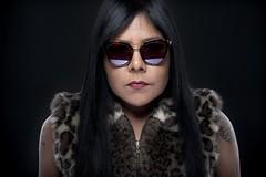 Cheetah 3414 (AM.Foto) Tags: portrait woman latina cheeta animalprint strobist studio lighting alienbees beautydish strobes thundergraysavagebackground amfoto aleandmarkldodge glasses shades reflection macromonday