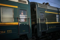 a Chinese official looking out of the Trans-Siberian Express (jrockar) Tags: transmongolian conductor canon5d3 l 1740 3 iii mark mk 5d 5d3 canon decisive instant moment candid streetphoto streetphotography street janrockar jrockar eastfromwest ordinarymadness madness ordinary oncearoundthesun journey trip travel official chinese man train railway express siberian trans transsiberian russia irkutsk