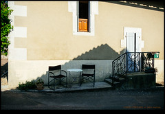 170621-2507-XM1.jpg (hopeless128) Tags: france 2017 eurotrip wall table shadows chairs champagnemouton nouvelleaquitaine fr