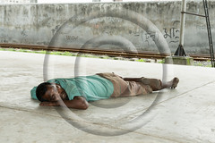 a man sleeping on the road (www.sohelparvezhaque.com) Tags: 2029years africandescent athleticism balance blackcolor casualclothing citylife comfortable cool danger exercising eyesclosed ghetto hiphop leisureactivity lifestyles lookingatcamera lyingdown males men oneperson recreationalpursuit relaxation relaxationexercise resting sitting skateboard skateboardpark skateboarding sleeping street urbanscene weekendactivities youngadult youthculture city day nigga outdoors people portrait serious summer