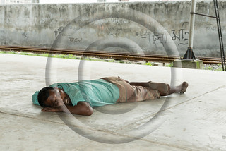 a man sleeping on the road