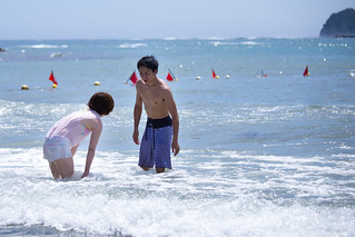 Young couple playing with water in the sea