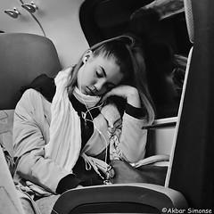 Sleeping by train (Akbar Simonse) Tags: holland netherlands nederland publictransport traveller trein train passagier girl sleeping streetphotography streetshot straatfotografie straatfoto people candid zwartwit blancoynegro bn bw monochrome vierkant square akbarsimonse