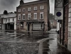 Tattoos (I line photography) Tags: reflection street buildings pub tattoo raining windows streetsigns roadmarkings