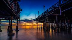 Hua Hin, Thailand at dawn (aotaro) Tags: ocean atdawn boardwalk restaurant sea fe1635mmf4zaoss seascape thai huahin sunrise ilce7m2 thailand