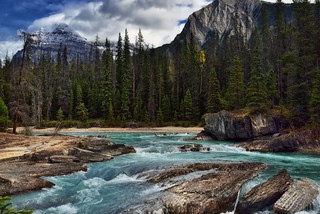 The Kicking Horse River Flowing By the Mountains at Natural Bridge (Yoho National Park)