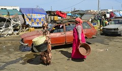 daily market (Breboen) Tags: dirty women black africa dress wreck car street senegal trash market saintlouis