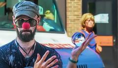 Fun With Orbs (Wes Iversen) Tags: detroit easternmarket michigan nikkor18300mm bokeh digitalart men motionblur painterly people rednose streetperformers women performers