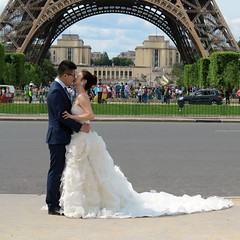 The kiss of the bride under the Eiffel Tower (pivapao's citylife flavors) Tags: paris france people champdemars wedding girl lovers architecture