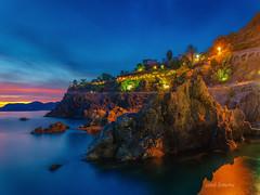italy (sandilesmana28) Tags: sunset blue hour beach coast slow speed star light rock itali landscape