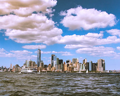 A view from the harbor (brianloganphoto) Tags: manhattan northamerica regions newyork hudsonriver clouds wtc urban worldtradecenter skycraper newyorkcity landcape sky boat unitedstates harbor skyline water