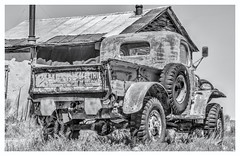 Like a Rock (magnetic_red) Tags: truck chevy old rusted abandoned blackandwhite building outdoors desert cabin house nevada americanwest