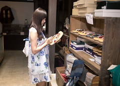 Young woman looking at Japanese Zori sandal in retail store (Apricot Cafe) Tags: img39145 2024years asia asianandindianethnicities japan japaneseethnicity japaneseculture katoricity sawarakatori sigma35mmf14dghsmart beautifulwoman blackhair candid carefree charming cheerful chibaprefecture colorimage cultures customer day enjoyment getasandal happiness horizontal indoors lifestyles longhair oneperson onlyjapanese onlywomen onlyyoungwomen people photography realpeople retail shoes shopping sideview smallbusiness smiling store success sustainablelifestyle threequarterlength tourism tourist traveldestinations women youngadult katorishi chibaken jp