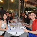 Honors students enjoy dinner out together on one of their first nights out in Athens.