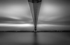Under the Bridge (mcalma68) Tags: pont de normandie france honfleur le havre long exposure black white waterfront river seine sky clouds symmetry sunset