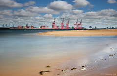 Liverpool2 (A view across the River Mersey from New Brighton Beach). (Away for a while, thanks.) Tags: liverpool2 newbrighton cranes rivermersey deepwaterport sand perchrock lighthouse clouds peelports sandbank canon eos 7dmarkii liverpooldocks merseyside