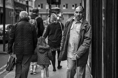 The Squeeze (Leanne Boulton) Tags: monochrome people urban street candid portrait portraiture streetphotography candidstreetphotography candidportrait streetportrait eyecontact candideyecontact streetlife man male face facial expression look emotion feeling mood eyes stress crowded tone texture detail depthoffield bokeh naturallight outdoor light shade shadow city scene human life living humanity society culture canon canon5d 5dmarkiii 70mm character ef2470mmf28liiusm black white blackwhite bw mono blackandwhite glasgow scotland uk