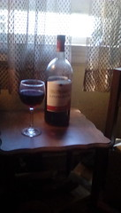 Red Rose' wine!, (Maenette1) Tags: wine red rose livingston bottles glass table wood window curtains menominee uppermichigan flicker365