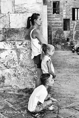 P1130390 (Francesco Pala) Tags: monocrome italy siena family children street candid mom