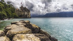 Château de Chillon (karolklaczynski) Tags: fuji fujifilm xt1 switzerland swiss valais alps swissalps montreux chateau chillon lake geneve water castle rocks longexposure long exposure clouds cloudy mountain mountains badweather reflection architecture samyang 12mm