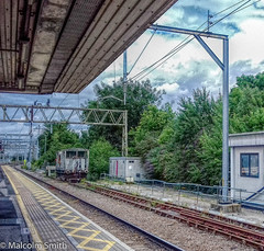 Shenfield Station (M C Smith) Tags: platform station wagon brake trees green sky blue white clouds yellow lines ballast track buildings windows buffers fence power canopy