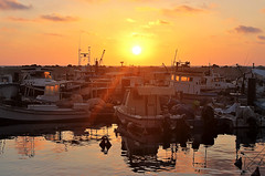 Trough the boat's windows (Photogioco) Tags: sunsets mare mediterraneo mediterraneansea fishingport red oldcity orange sea beautiful boats lifestyle lights