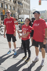 Lloyd and Chris Voth, handing off to Miranda Issacs (Keith Levit) Tags: canadasummergames chrisvoth keithlevitphotography lloyd mirandaissacs tor winnpegtorchrelay