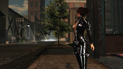 Whats a girl gotta do to get a taxi in New York? (alexandriabrangwin) Tags: alexandriabrangwin secondlife 3d cgi computer graphics virtual world photography new york city street shiny glossy black rubber latex catsuit bondage buckles fishnet unzipped waiting taxi sidewalk smoke fog mist dark buildings trees