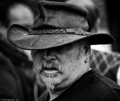 TOGG and the earring. (Neil. Moralee) Tags: middevonshow2017neilmoralee neilmoralee man face portrait close hat downcast beard moustache old mature farmer farm togg earring wet raining damp contrast black white mono monochrome bandw blackandwhite bw devon show mid neil moralee nikon d7200 candid uk agriculture people outdoors weather rain