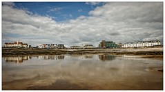 Porthcawl Seafront (tina777) Tags: porthcawl seafront beach seaside sand rocks sky sea clouds reflections water wet houses flats shops grand pavillion photoshop elements 13 topaz adjust dramatic ononesoftware wales cymru