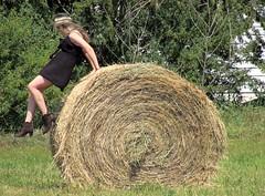 Jumping off (thomasgorman1) Tags: hay bale farm canada mundare alberta canon rural town agricultural jumping woman person fun field