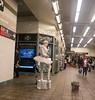 Subway Ballerina Mime (UrbanphotoZ) Tags: ballerina mime subway white tutu tulle boa cap tips recordmart busker fluorescent est1958 electronics exit passengers arcade timessquare midtown westside manhattan newyorkcity newyork nyc ny